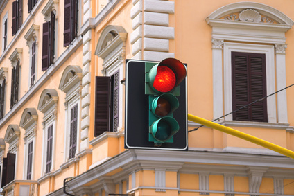 Traffic lights at the crossroads of the city is lit red